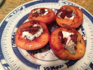 I rarely photograph my cooking creations, but here's an experiment with grilled peaches stuffed with goat cheese and pancetta.