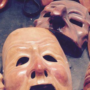 Carnival masks in Venice shop window.