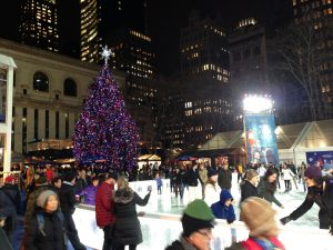 Ice skating in Bryant Park behind the New York Public Library, 5th Avenue branch.